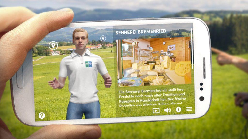 App mit Avatar und Infografik ist auf weißem Smartphone vor Berglandschaft zu sehen